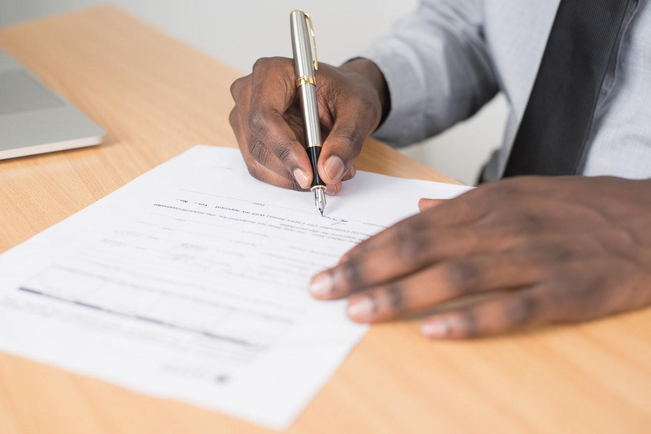 Person signing a business document