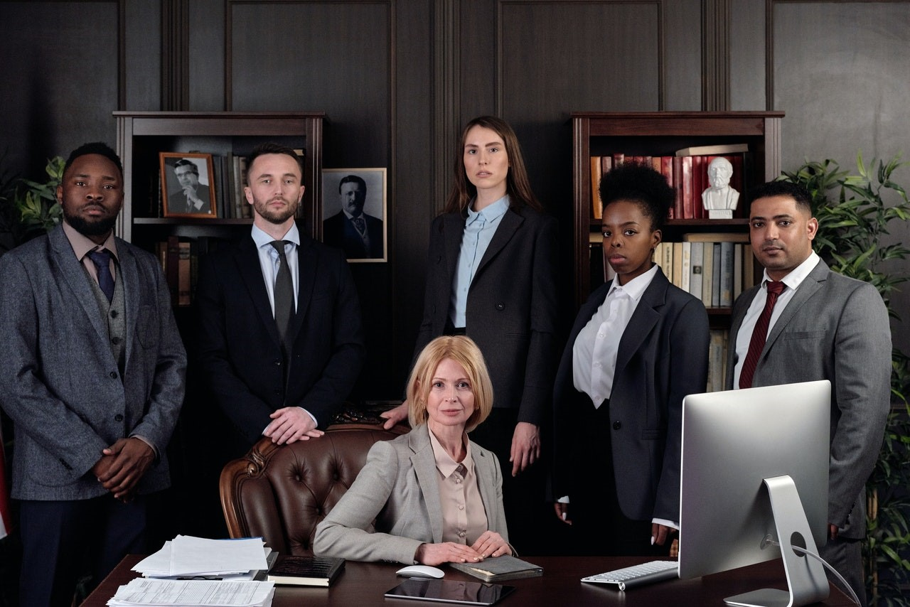Legal team standing around a desk
