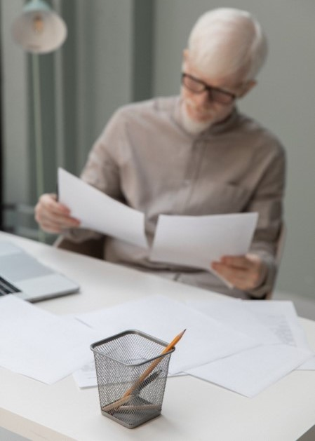 Person sitting at desk reading documents
