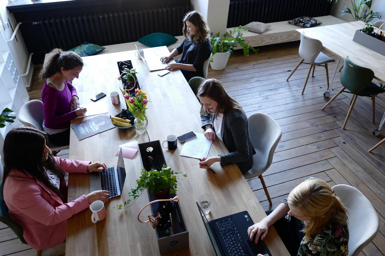 People sitting around a desk working