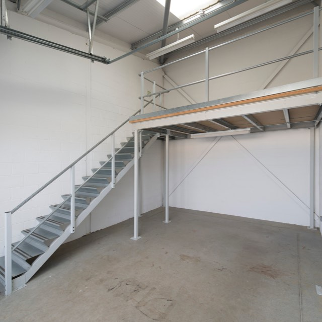 Empty unit space showing mezzanine