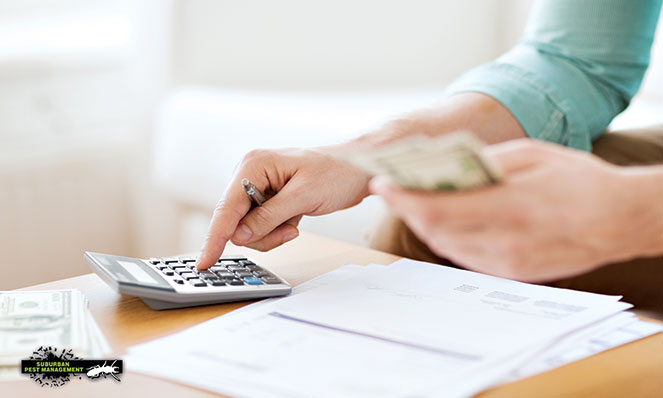 image of person with calculator, cash and paperwork