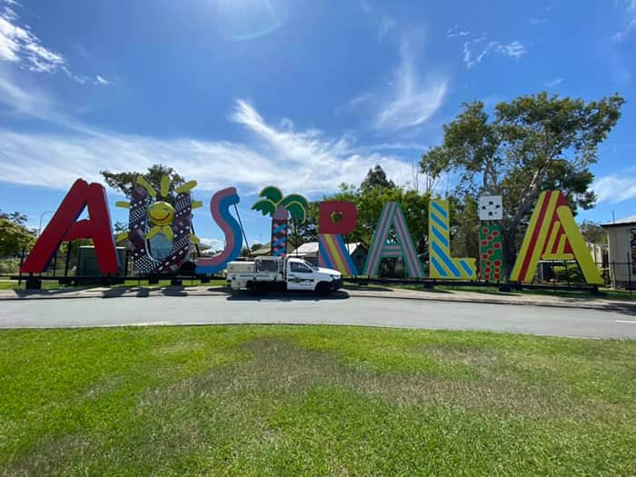 SPM Ute parked in front of the big Australia sign at Caboolture Historical Village