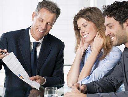 financial advisor in meeting with clients