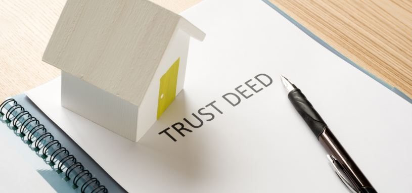 a trust deed on a table