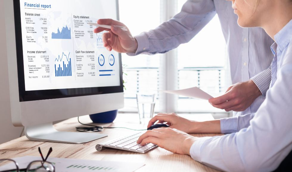 accountants working on financial accounts using accounting software