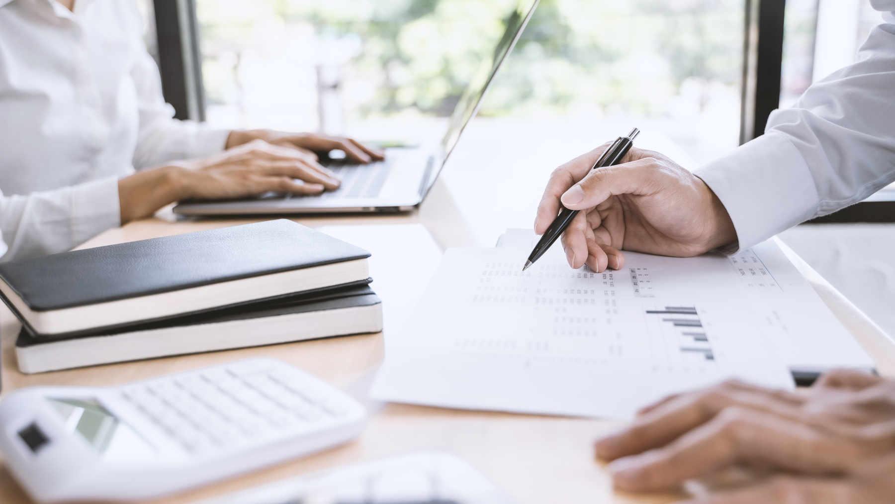man calculating corporate tax