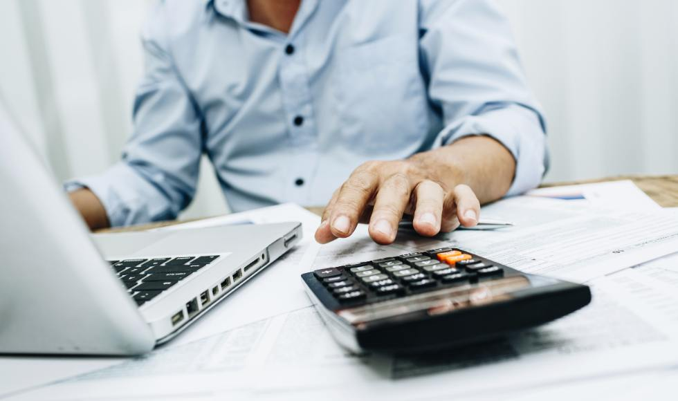 Person working out tax with calculator