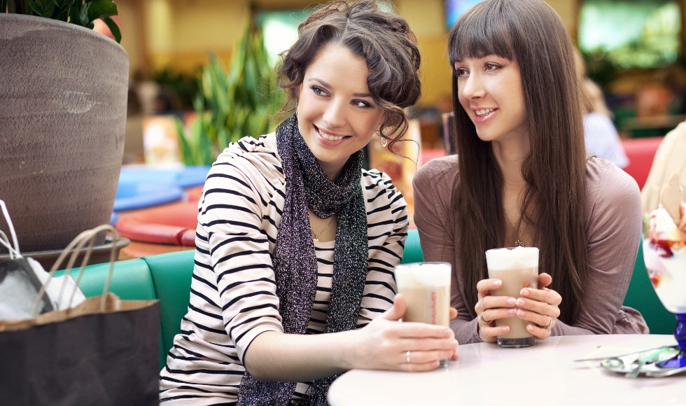 women enjoying coffee in food court