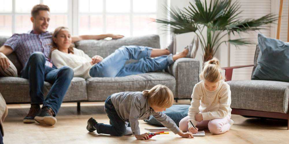 family in home playing with children