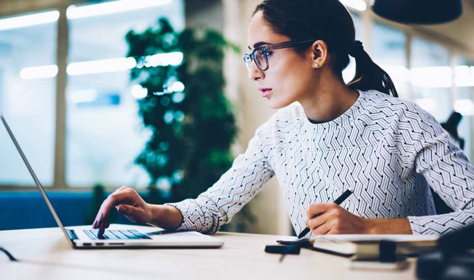 Woman determining the cost of SMSF accounting