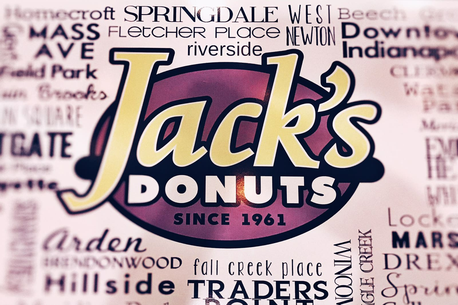 Jack's Donuts logo centered in a collage of all the nationwide locations