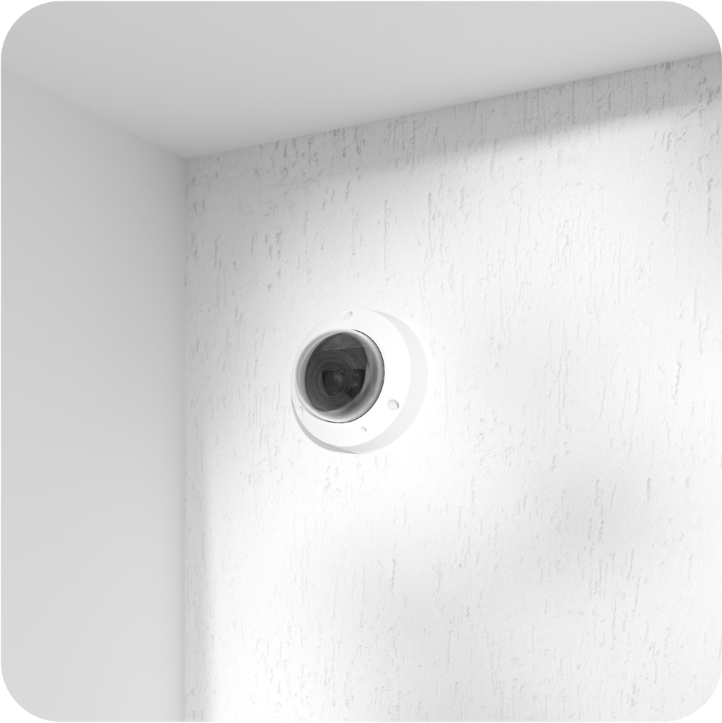 Latch Camera installed on the exterior of a white building.