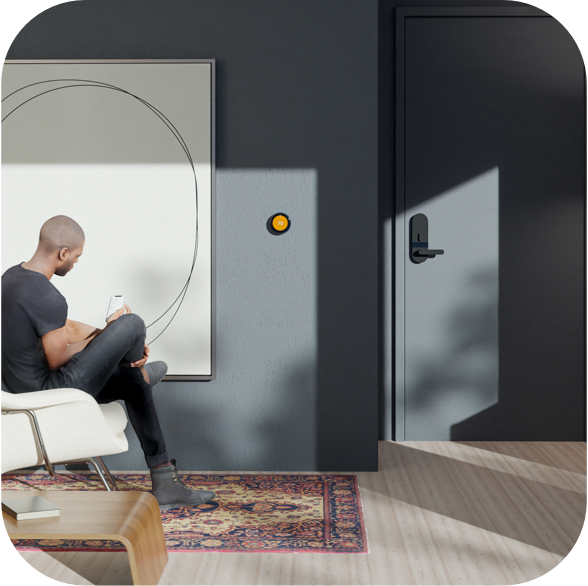 Man in furnished apartment with Latch on door, Google Nest and smart light on wall, and Latch Hub on ceiling.
