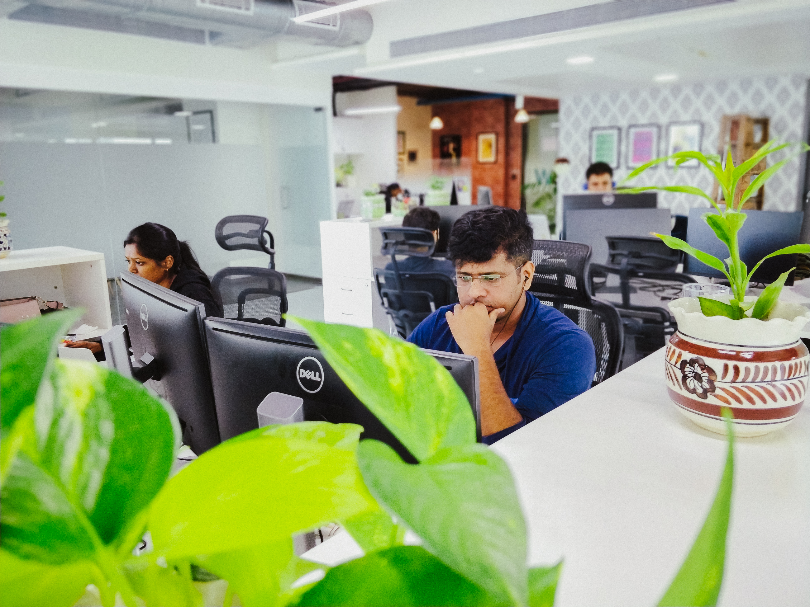 Focused coworkers at their desks in the Mumbai office.