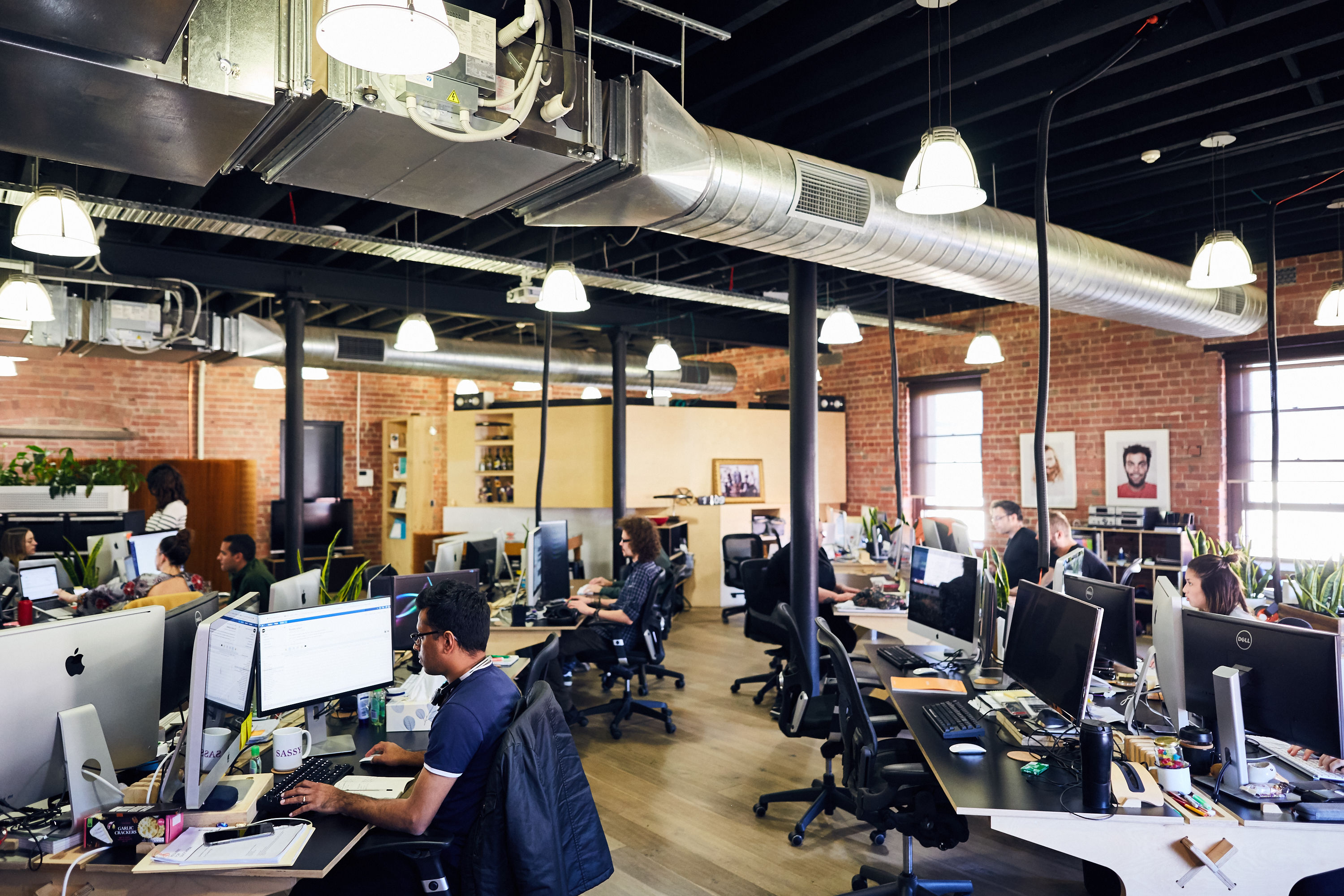 Photo of people working in a warehouse converted office