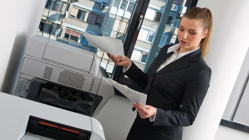 woman deciding on wether to choose renting or buying a photocopier