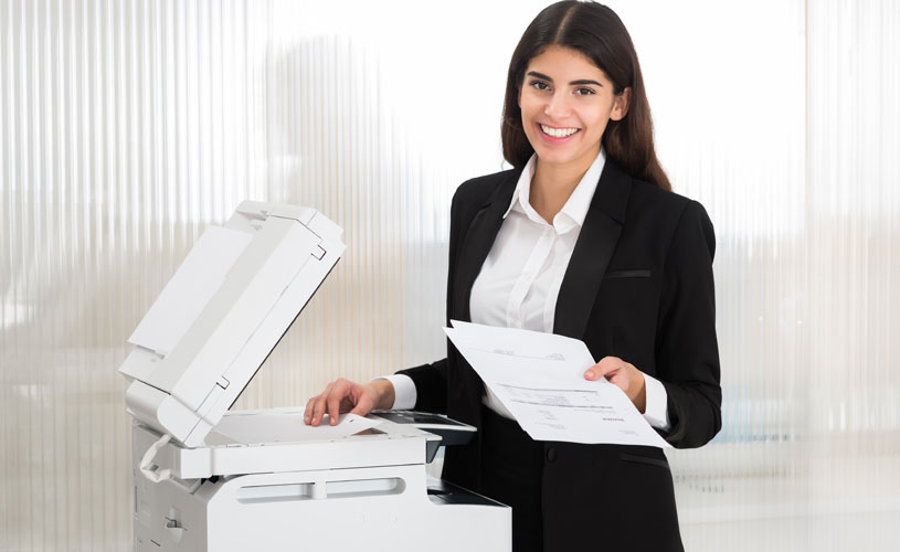 businesswoman completing some photocopier servicing