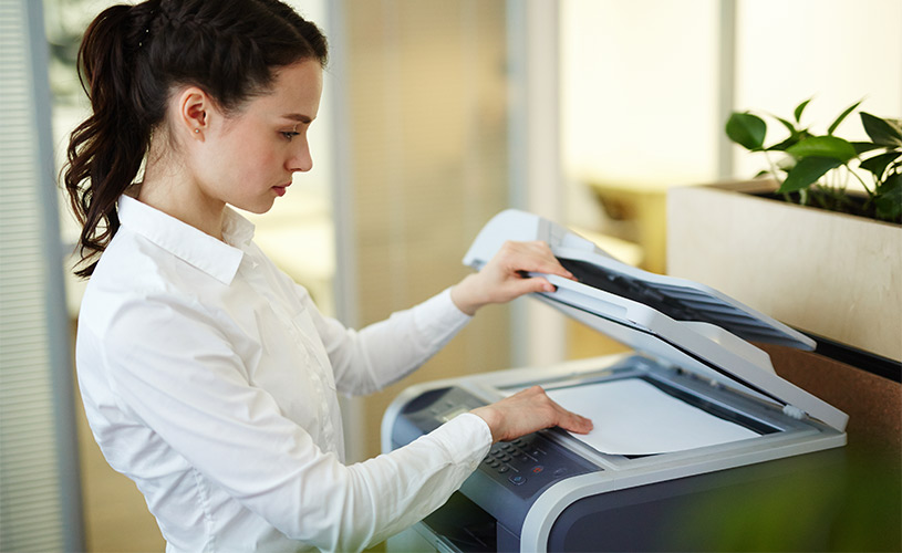 woman using a photocopier rental