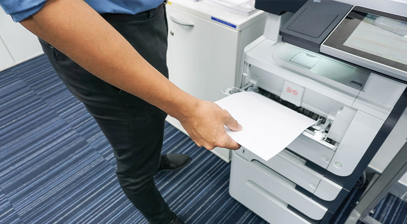 Man taking paper from printer