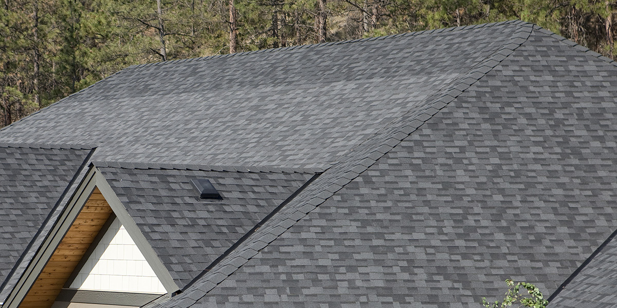 a roof where someone has installed mismatched shingles