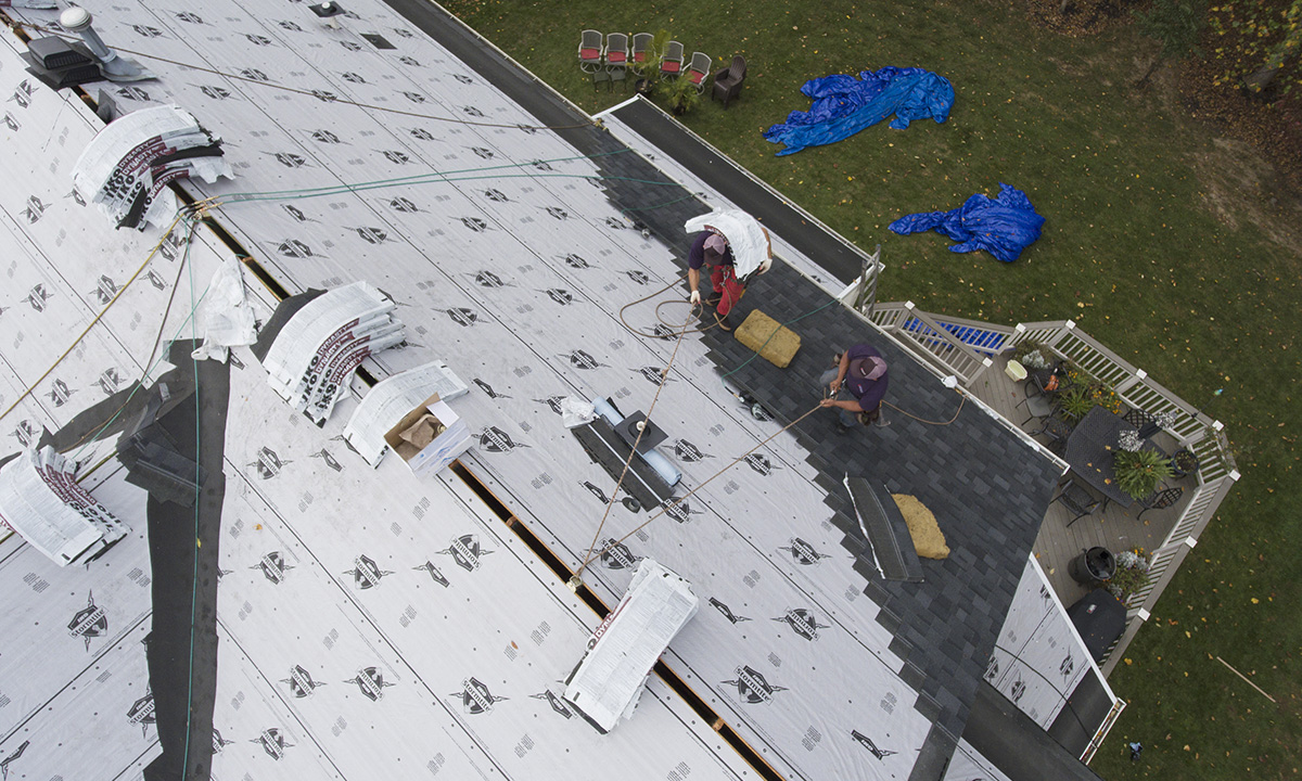 roofers installing shingles