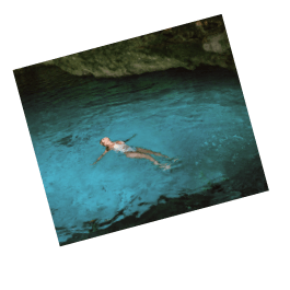Woman floating on back in water.
