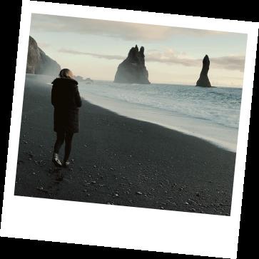 Person walking on beach.