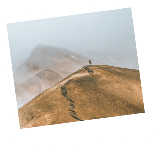 Person standing on top of mountain.