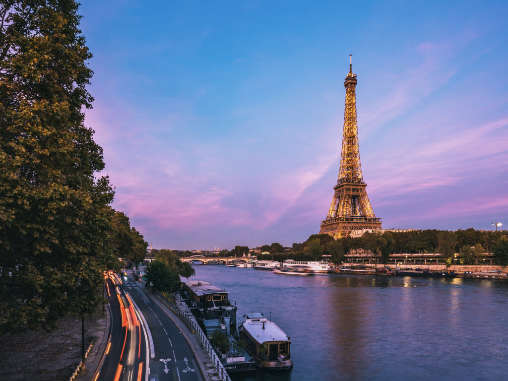 Paris Eiffel tower and river at sunset