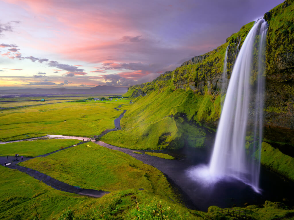 waterfall and green hillsides