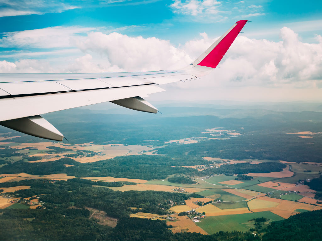 Norwegian Air plane flying over landscape