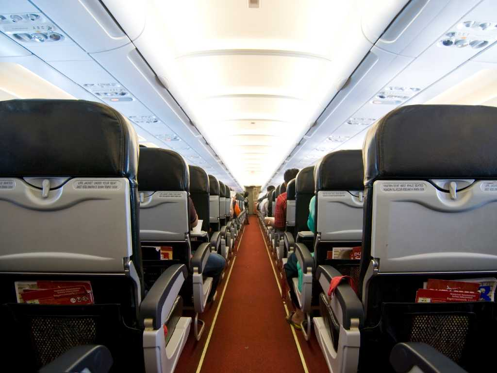 image of airline interior in economy class