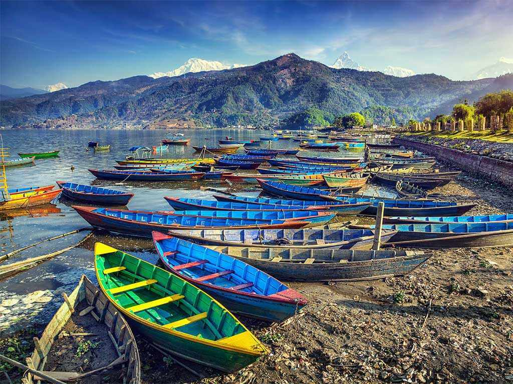 Colorful boats along the shore in Nepal