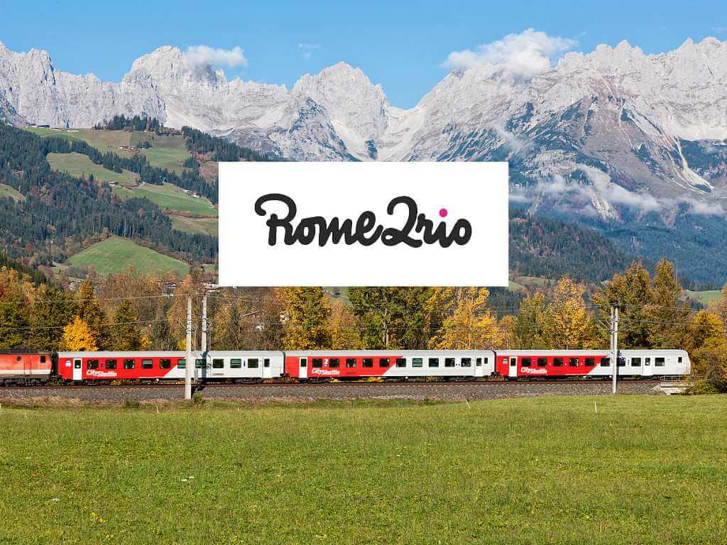 train through the Swiss mountains with Rome2Rio logo