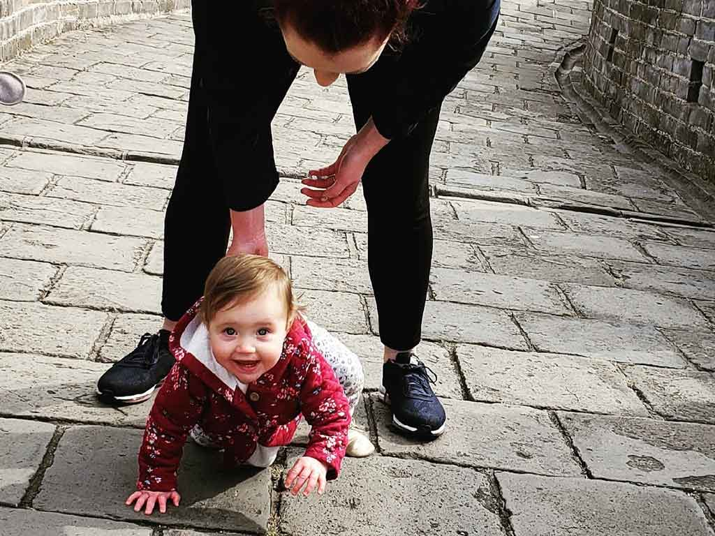 Scott's Cheap Flights member Sarah on the Great Wall of China with baby