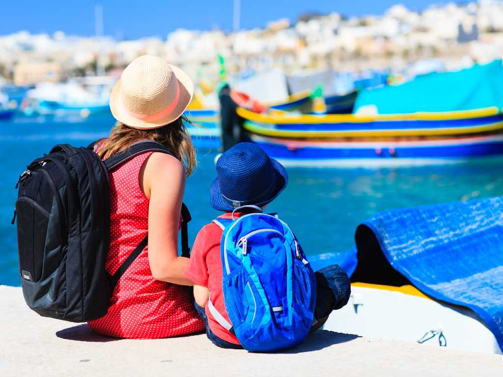 mother and son looking at boats in Malta