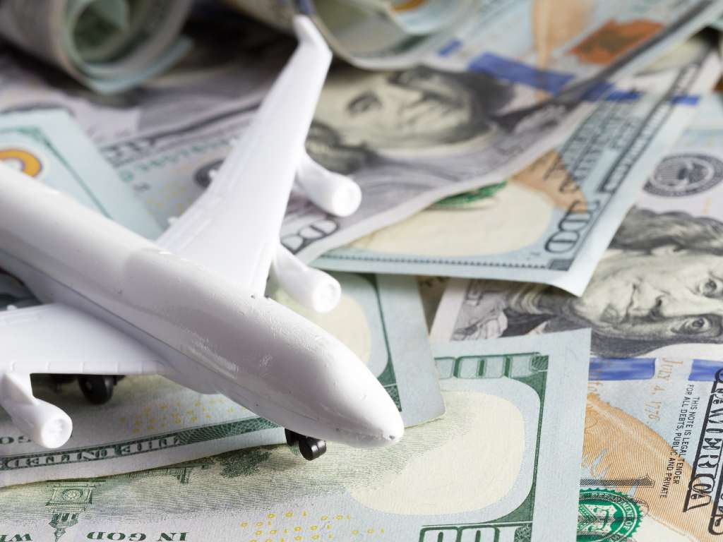 toy plane on currency