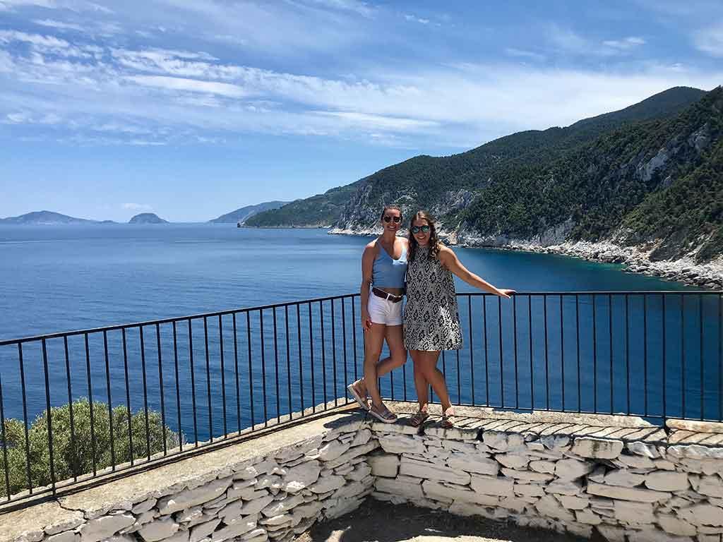 Two women overlooking ocean in Greece.