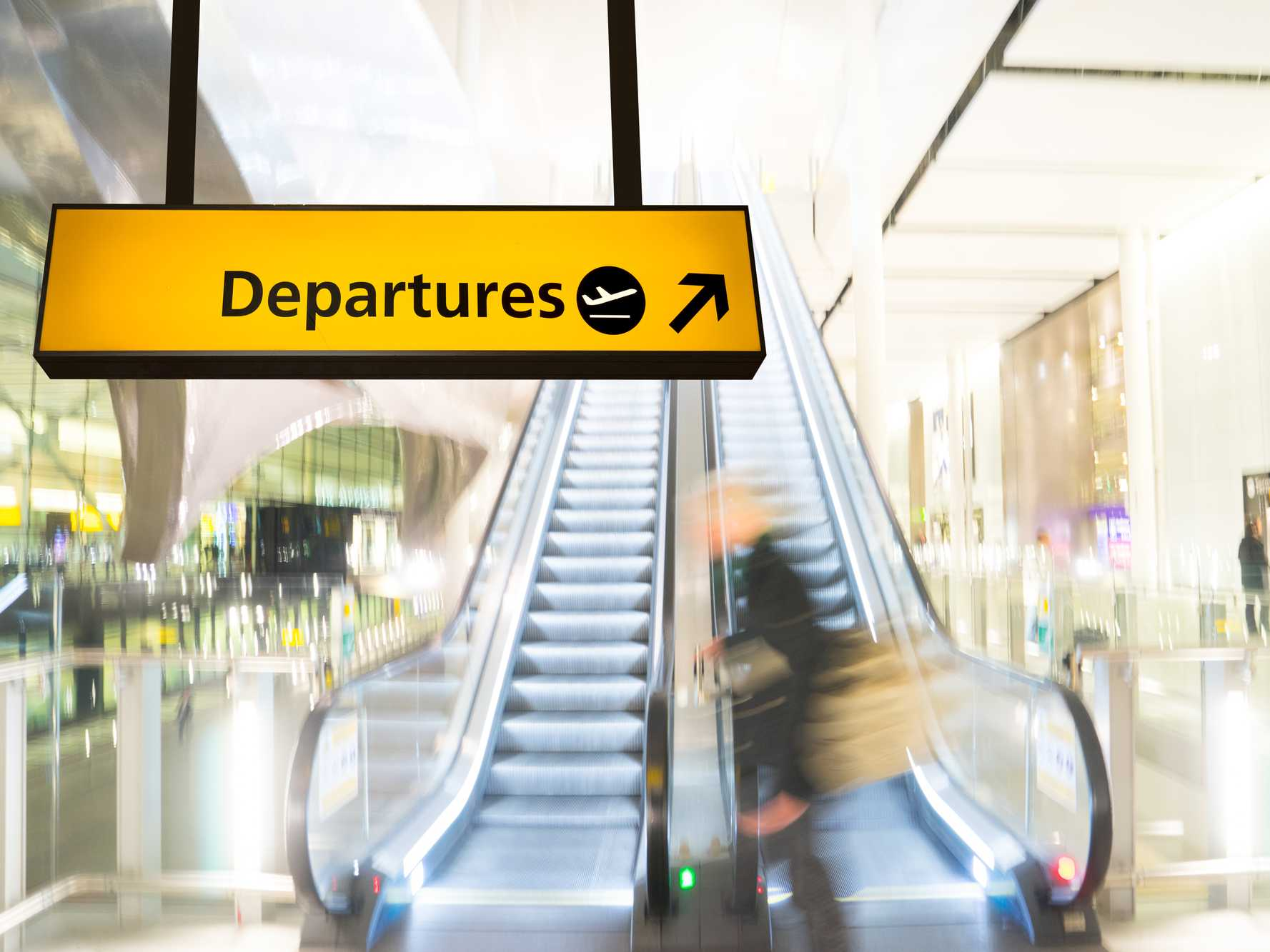airport scene with departures sign.