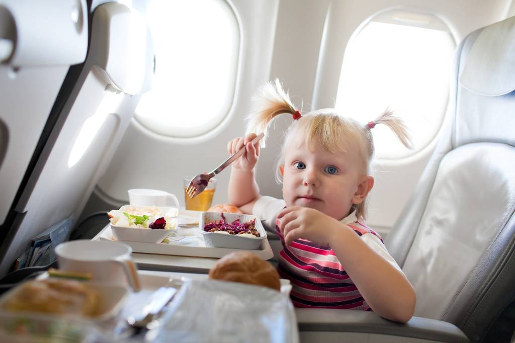 child eating on a plane