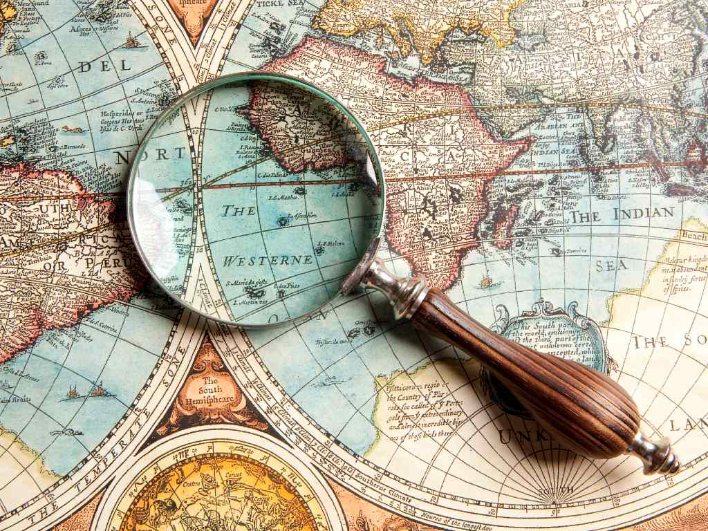 magnifying glass over world map