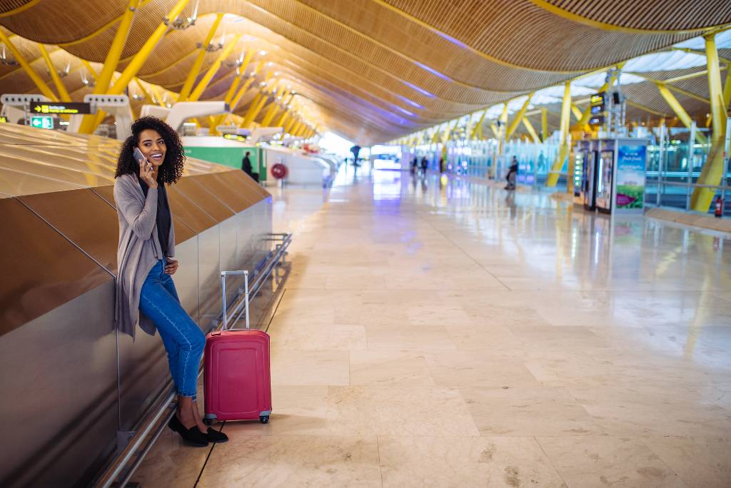 traveler with carryon bag