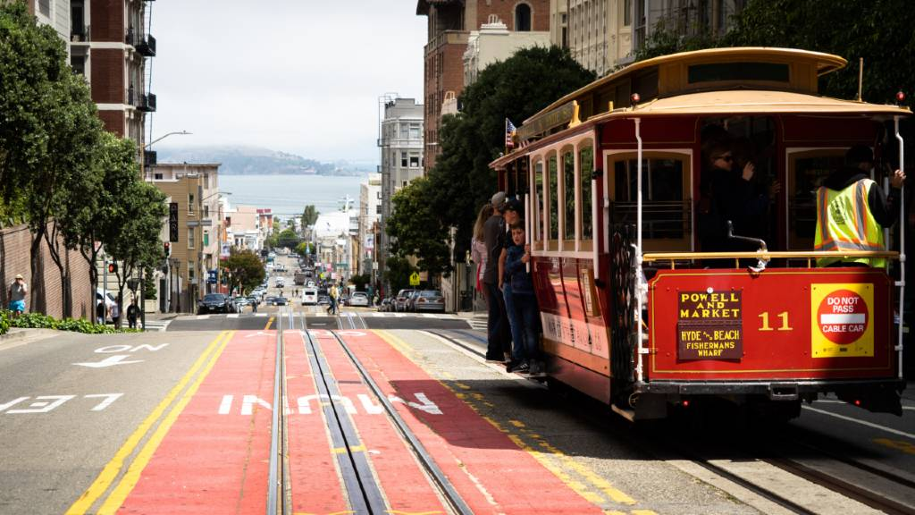 cable car cresting a hill in San Francisco