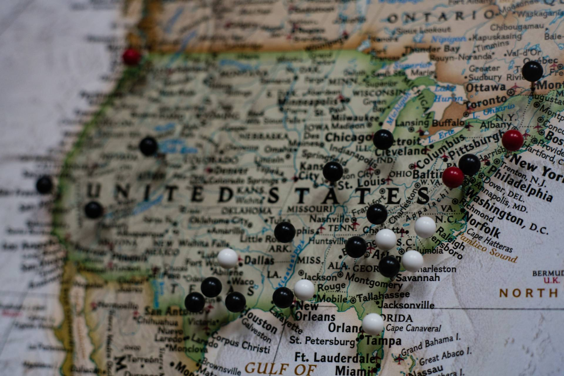 us map with pushpins in various cities.