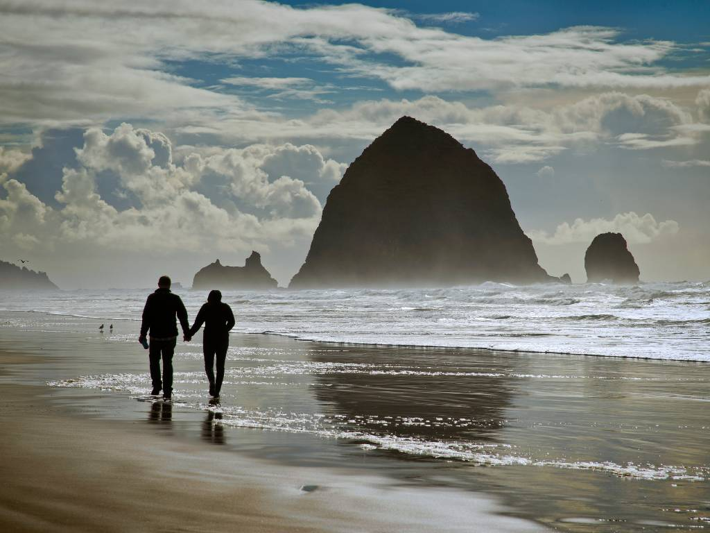couple walking on Cannon beach.