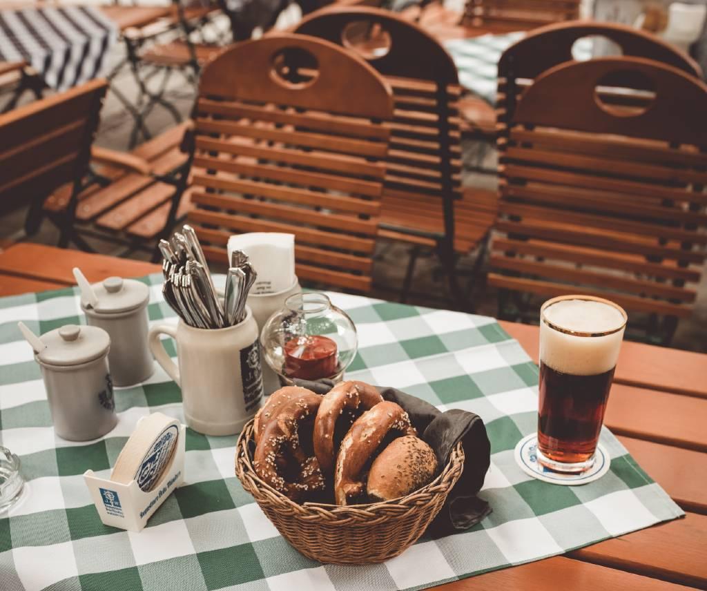 pretzels and beer on table in Munich beer garden