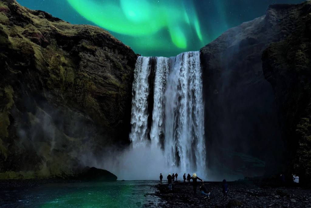Northern Lights over waterfall in Iceland
