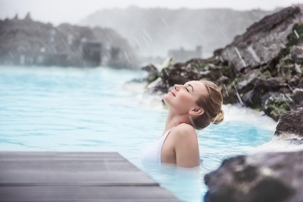 person soaking in Blue Lagoon