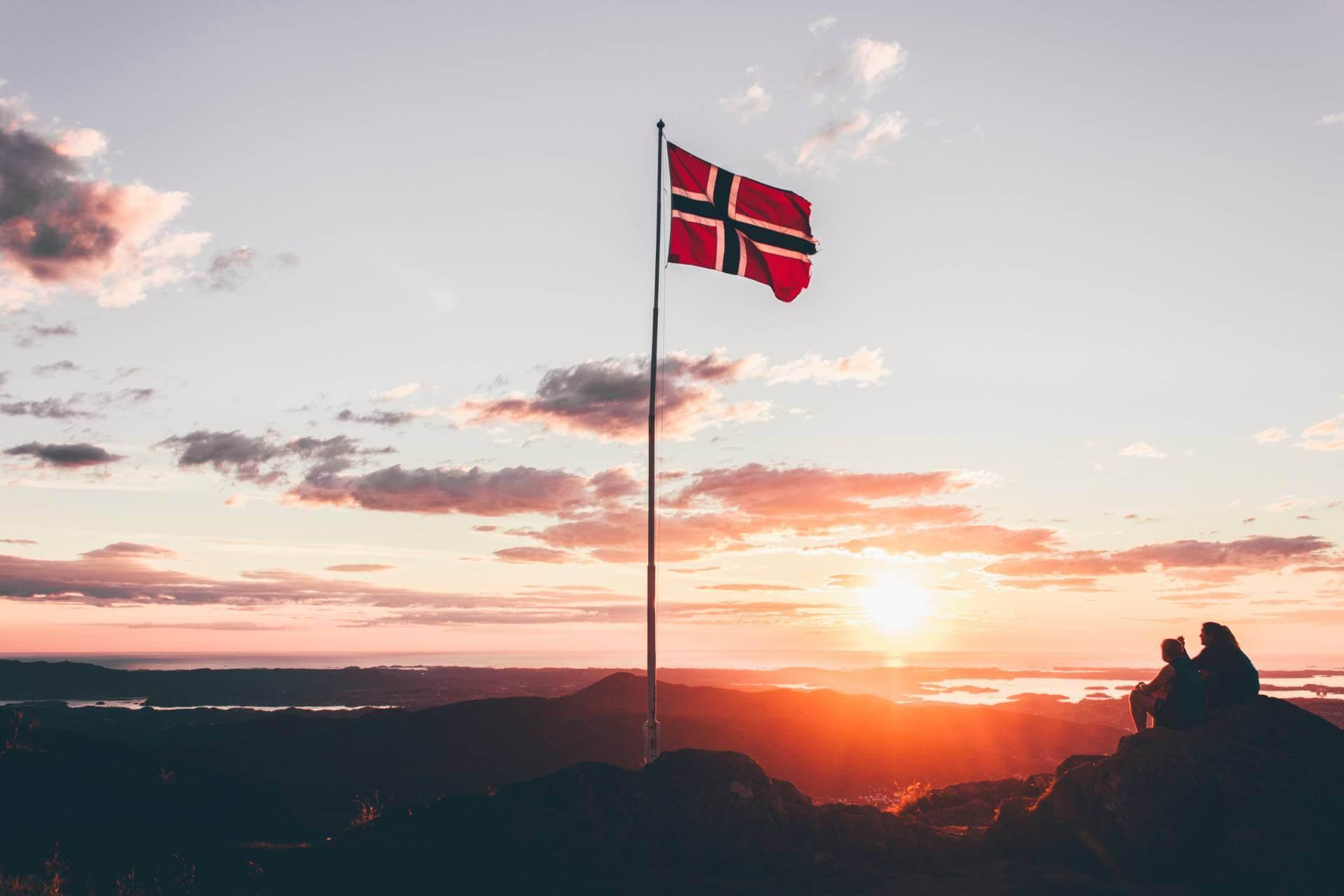 Norwegian flag on a mountain.